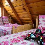 2 camas matrimoniales cómodas en cabaña de El Pital Lecho de Flores